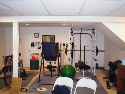 My home gym - I no longer use the inversion table, but do a lot of TRX